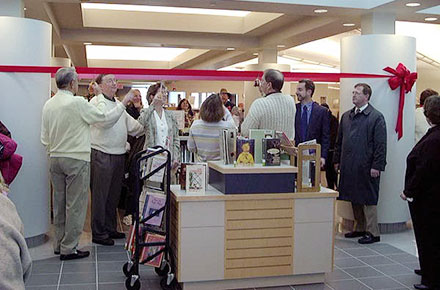 Cutting the ribbon during Grand Opening of renovated library, 2000